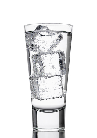 carbondioxide: Glass of sparkling mineral water with ice cubes on white background