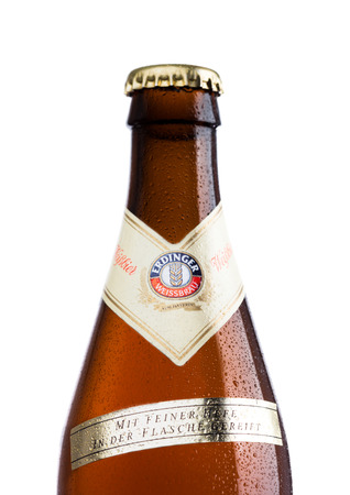LONDON, UK - MARCH 15, 2017: Bottle of Erdinger wheat beer on a white background.Erdinger is the product of the worlds largest wheat beer brewery.