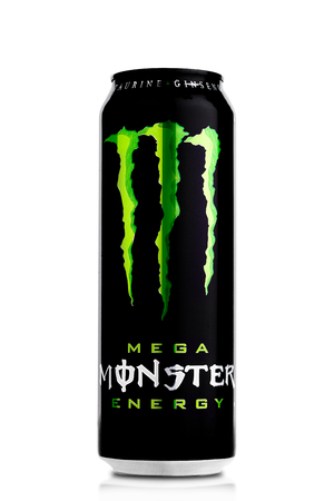 LONDON, UK - APRIL 12, 2017:  A can of Monster Energy Drink on white background. Introduced in 2002 Monster now has over 30 different drinks with high a caffeine content. Redakční