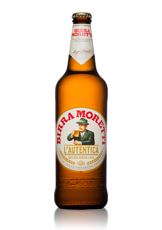 LONDON, UK - MAY 15, 2017: Bottle of Birra Moretti beer on white background, Italian brewing company, founded in Udine in 1859 by Luigi Moretti