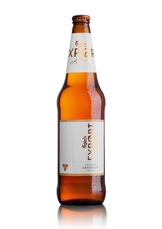 LONDON, UK - MAY 15, 2017: Bottle of Carlsberg Export beer on white background, Danish brewing company founded in 1847 with headquarters located in Copenhagen, Denmark Editorial