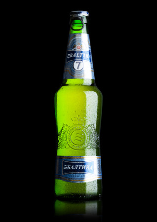 LONDON, UK - MAY 15, 2017: A bottle of Baltika Lager beer number Seven premium on black background. Baltika is the second largest brewing company in Russia. Editorial