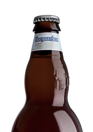 LONDON, UK - MAY 29, 2017: Bottle of Hoegaarden wheat Belgian beer on white background. Belgium and the producer of a well-known wheat beer.