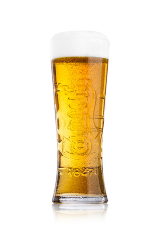 LONDON, UK - MAY 29, 2017: Cold glass Of Carlsberg beer on white background. Danish brewing company founded in 1847.