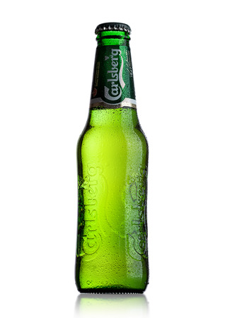 LONDON, UK - MAY 29, 2017: Bottle Of Carlsberg beer on white background. Danish brewing company founded in 1847. Editorial