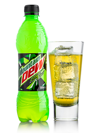 famous industries: LONDON, UK - JUNE 9, 2017: Bottle and glass of Mountain Dew drink on ice isolated on white background. Mountain Dew citrus-flavored soft drink produced by PepsiCo.