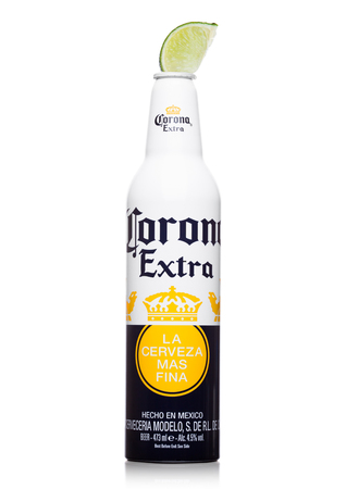 LONDON, UNITED KINGDOM - JUNE 22, 2017: Aluminium Bottle of Corona Extra Beer with lime slice on white background. Most popular imported beer in the US. Limited edition bottle.