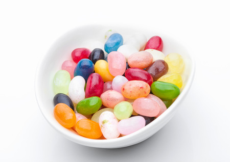rubbery: Jelly beans sweet colorful candies in white bowl on white background