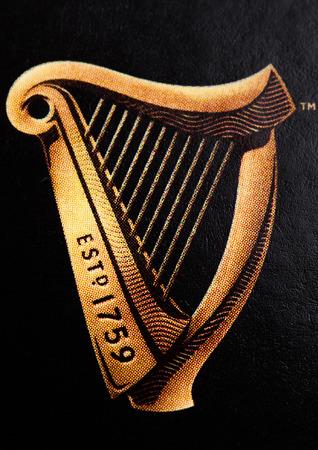 LONDON, UK - OCTOBER 20, 2017: Logo of Guinness original beer on white background. Guinness beer has been produced since 1759 in Dublin, Ireland.Macro
