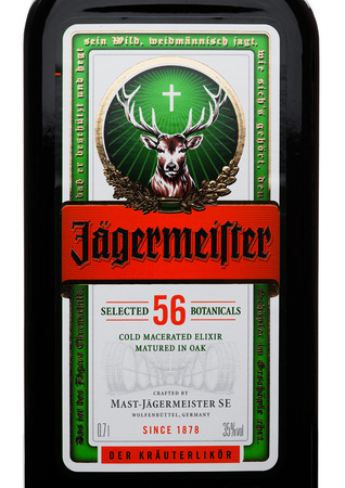LONDON, UK - NOVEMBER 03, 2017: Label of Jagermeister on white background. German digestif made with 56 herbs and spices.