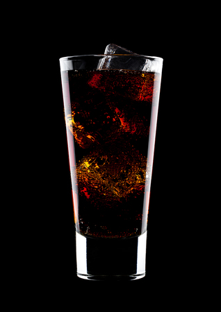 Glass of cold cola soda drink with ice cubes on black background Stock Photo