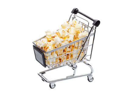 old desk: Popcorn salty sweet snack in shopping carton white background