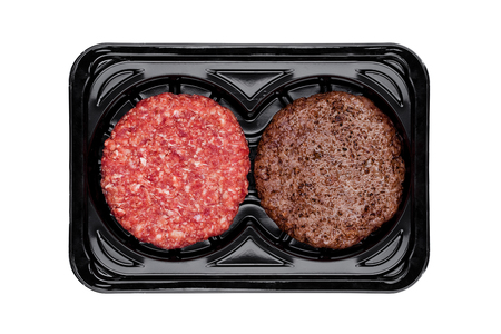 Raw and fried fresh beef burgers in plastic tray on white background Stock Photo