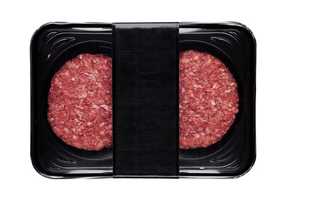 Raw fresh beef burgers in plastic tray on white background Stock Photo