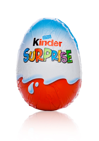 LONDON, UK - November 17, 2017: Kinder chocolate egg on white background.Kinder bars are produced by Ferrero founded in 1946.
