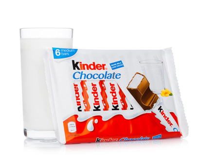 LONDON, UK - November 17, 2017: Kinder chocolate bar and milk glass on white background.Kinder bars are produced by Ferrero founded in 1946.