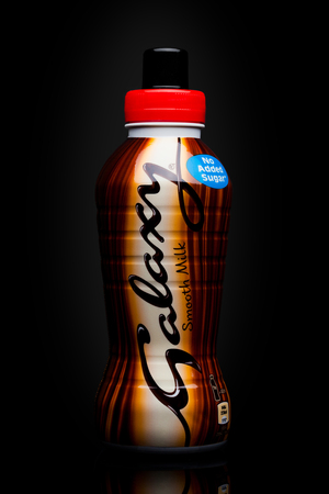 LONDON, UK - November 17, 2017: Bottle of Galaxy Smooth Milk Drink on a black background, made and marketed by Mars, Incorporated,