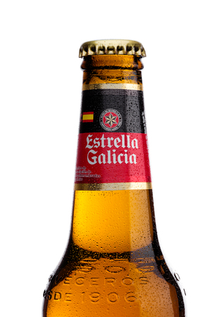 LONDON, UK - November 17, 2017: Bottle of Estrella Galicia pale lager draft beer on white background. Estrella Galicia is produced by Hijos de Rivera Brewery in La Coruna,Spain since 1906.