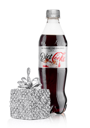 LONDON, UK - November 17, 2017 Bottle: of Diet Coca-Cola on White Background christmas edition with gift box. Coca-Cola is one of the most popular soda products in the world.