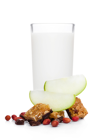Cereal bar bits with apple chocolate and peanuts on white background