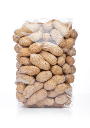Clear pack of peanuts on white background