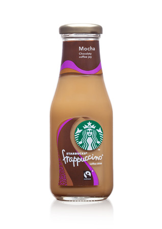 LONDON, UK -DECEMBER 07, 2017: Glass bottle of Starbucks frappuccino coffee drink on white background. Seattle based Starbucks is the largest coffeehouse company in the world.