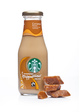 LONDON, UK -DECEMBER 07, 2017: Glass bottle of Starbucks frappuccino coffee drink with caramel on white background. Seattle based Starbucks is the largest coffeehouse company in the world. Editorial