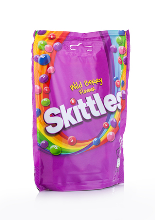 LONDON, UK -DECEMBER 07, 2017: Skittles Candy Pack Wild Berry on white background. Skittles is a brand of fruit flavoured sweets.
