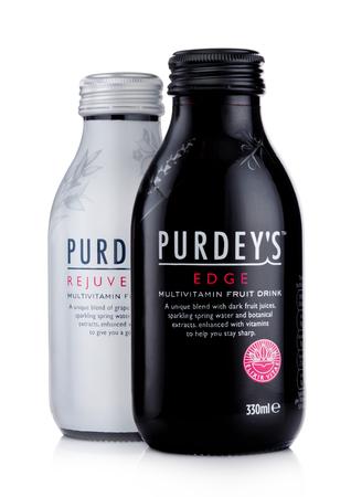 LONDON, UK -DECEMBER 15, 2017: Bottles of Purdeys multivitamin juice drink on white background.