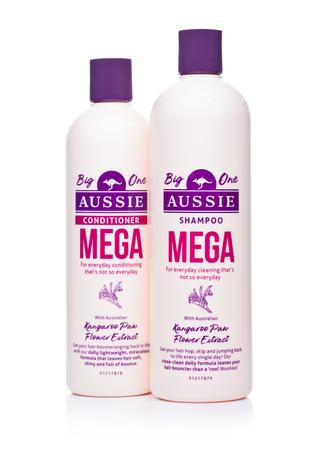 LONDON, UK - JANUARY 02, 2018: Bottles of Aussie Mega Shampoo conditioner on white background.
