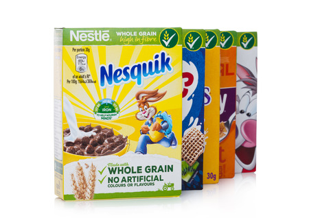 LONDON, UK - JANUARY 10, 2018: Packages of Nestle whole grain ceral for breakfast on white background.Product of Nestle Editorial