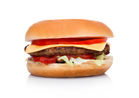 Classic beef cheeseburger with vegetables and sauce on white background Foto de archivo
