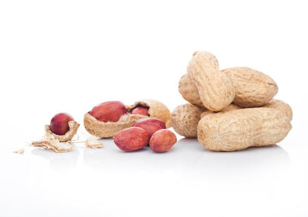 Raw peanuts with shell on white background with reflection