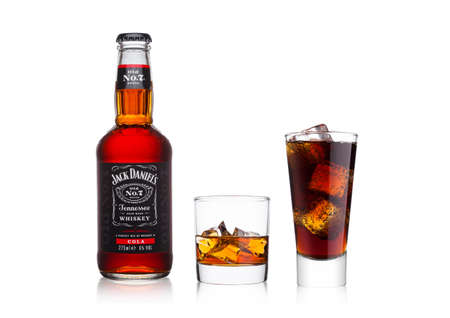 LONDON, UK - JANUARY 20, 2018: Bottle of Jack Daniels and cola mixed with whiskey glass and cola on white background. Editorial