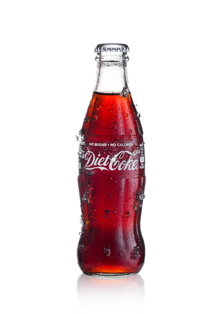 LONDON, UK - JANUARY 20, 2018: Cold glass bottle of Diet Coca Cola drink  with ice and dew on white background. The drink is produced and manufactured by The Coca-Cola Company.
