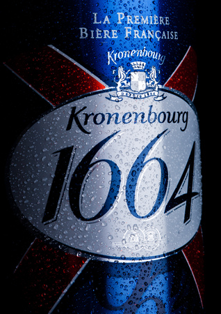 LONDON, UK - JANUARY 02, 2018: Cold bottle of Kronenbourg 1664 beer on black background with dew. A 5.5% pale lager is the main brand of Kronenbourg Brewery owned by the Carlsberg Group Editorial