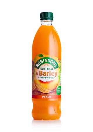 LONDON, UK - FEBRUARY 02, 2018: Bottle of Robinsons Fruit Juice with peach on white background.