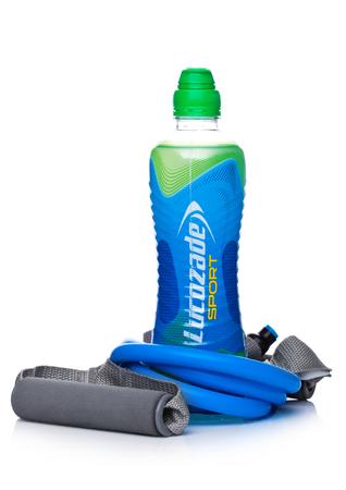 LONDON, UK - FEBRUARY 02, 2018: Bottle of Lucozade sport energy soda drink with resistance band  on white background.