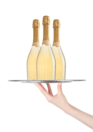 Hand holds tray with yellow champagne bottles on white background