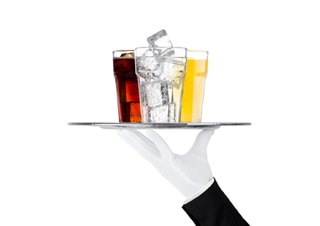 Hand with glove holds tray with cola orange water soda drinkon white background