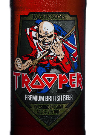 LONDON, UK - FEBRUARY 14, 2018: Cold Bottle label of Trooper Premium British Beer on white background. Created by Iron Maiden.