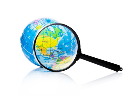 Globe under magnifying glass zooming North America, Mexico and Canada on white background 写真素材