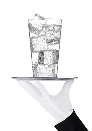 Hand holds tray with sparkling water soda drink on white background Stock Photo
