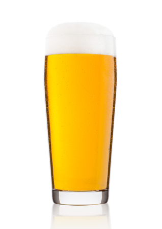 Cold glass of lager beer with foam and dew isolated on white background Stock Photo