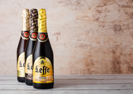 LONDON, UK - MARCH 10, 2018 : Cold bottles of Leffe beer on wooden background.Leffe is made by Abbaye de Leffe in Belgium. Editorial