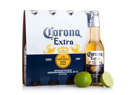 LONDON, UK - MARCH 10, 2018 : Pack of four bottles of Corona extra beer with lime on white background.Corona is the most popular imported beer in the US. Editorial