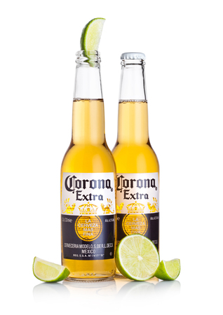 LONDON, UK - MARCH 10, 2018 : Bottles of Corona Extra Beer with lime slice on white background.Corona is the most popular imported beer in the US. 報道画像