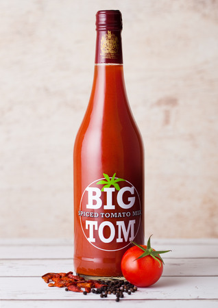 LONDON, UK - MARCH 10, 2018 :  Glass bottle of Big Tom spiced tomato mix on wooden background.A powerful blend of spices to make the ultimate Bloody Mary Mix