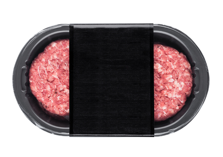 Raw fresh beef burgers in plastic tray on white background with black label Stock Photo