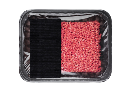 Plastic tray with frew raw beef pork lamb mince with black label Stock Photo